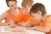 Mother draws with his sons — Stock Photo