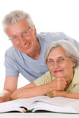 Elderly couple together on a white — Stock Photo