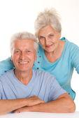 Elderly couple on a white — Stock Photo