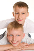 Two brothers on a white — Stock Photo