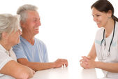 Doctor and an elderly couple — Stock Photo