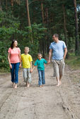 Rambling family in the forest — Stock Photo