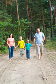 Happy family in the forest — Stock Photo
