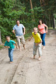 Family in the forest — Stock Photo
