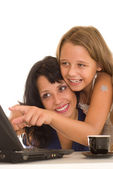 Mom and daughter a laptop — Stock Photo