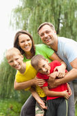 Happy boys with family — Stock Photo