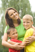 Boys with mom in the park — Stock Photo