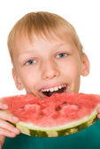 Handsome boy eating watermelon — Stock Photo