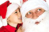 Santa with child on a white — Stock Photo