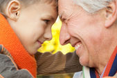 Grandfather keeps his grandson — Stock Photo