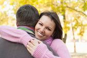 Couple in a autumn park — Stock Photo