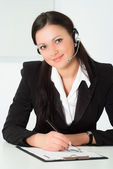 Nice girl in a black business suit with a white — Stock Photo
