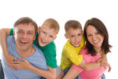 Happy famaly in a color clothes — Stock Photo