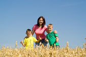 Happy mother with two boys — Stock Photo