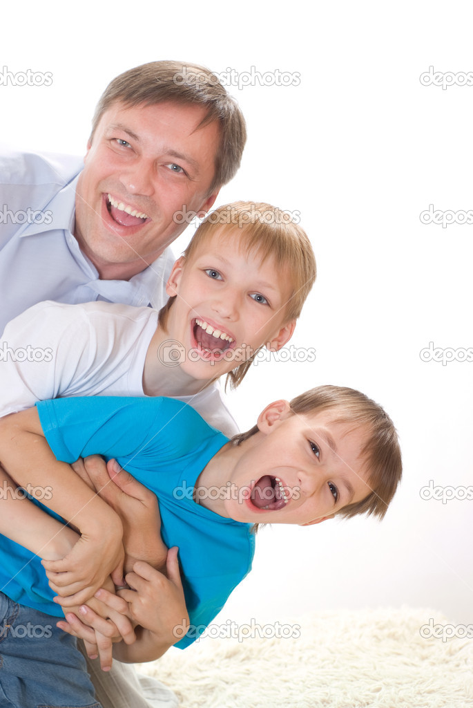 Happy dad with two children on a white — Stock Photo #5512462