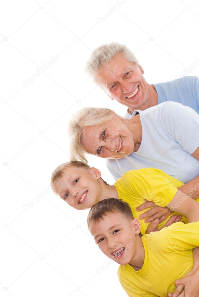 Happy family of four on a white background — Stock Photo #5514178