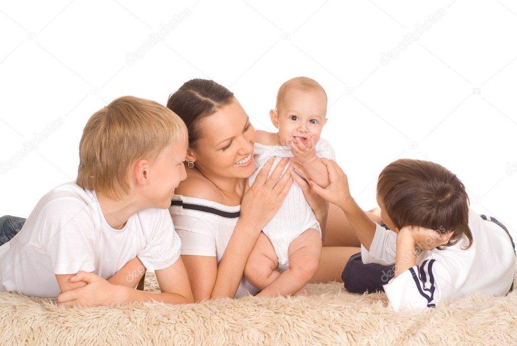 Nice family of four on a white  Stock Photo #5515660