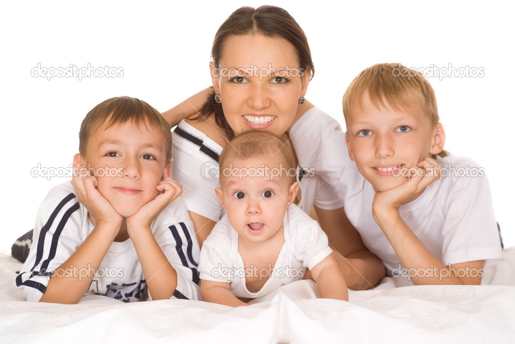 Nice family of four on a white  Stock Photo #5515662