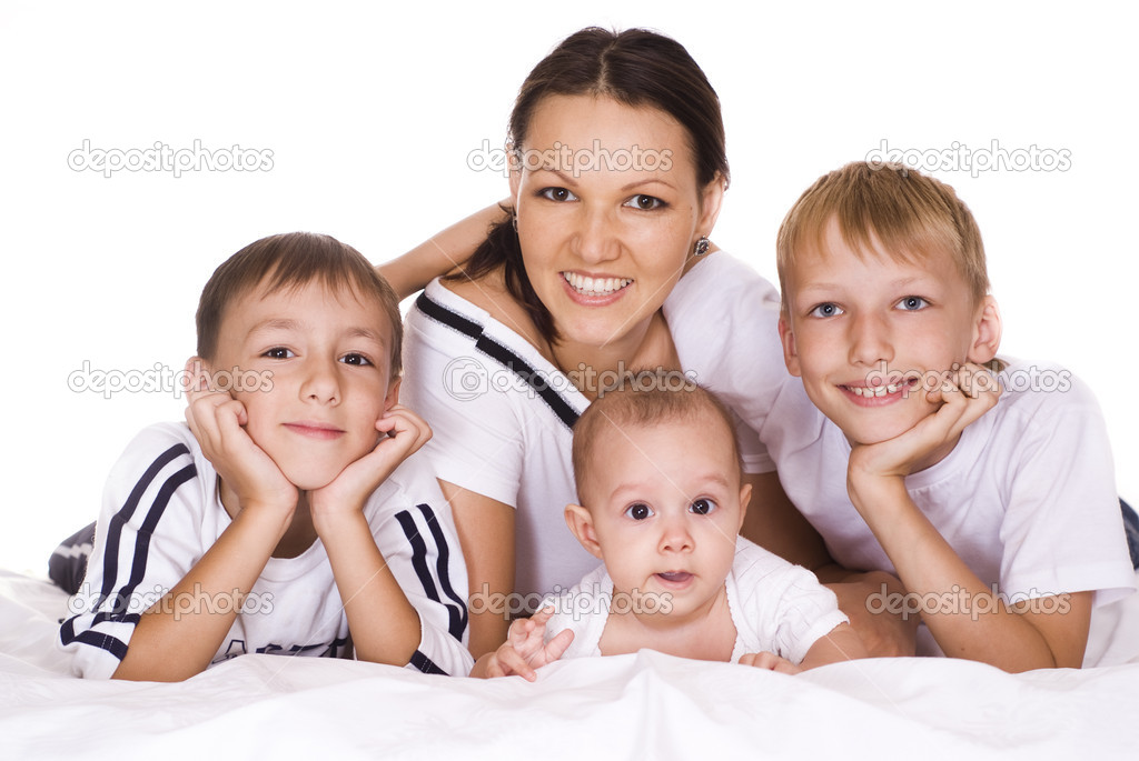 Nice family of four on a white  Stock Photo #5515663
