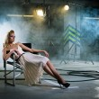 Girl in a chair under the rays — Stock Photo #5486545