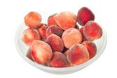 Peaches in plastic a bowl — Stock Photo