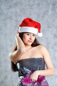 Young sexy Santa indress on grey — Stock Photo