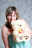 Sexy Blond Girl with teddy bear — Stock Photo