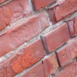 Weathered stained old  red brick wall background — Stock Photo