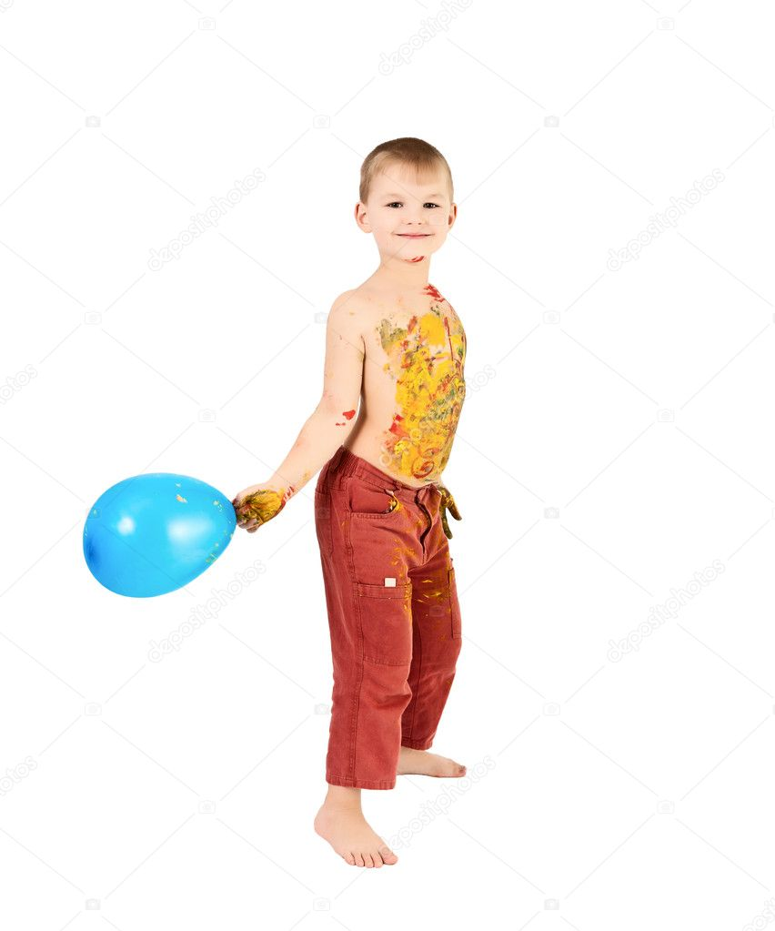 Adorable 3 year old boy covered in bright paint  Stock Photo #6276672