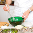 Professional chef hands with kitchen utensils whisk and pan — Stock Photo