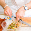 Stock Photo: Chef preparing salad