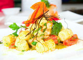 Gnocchi with pesto and prawns — Stock Photo