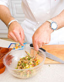 Chef preparing salad — Stock Photo