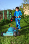 Kid lawn mower — Stock Photo