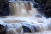 Faster waterfall running over rocks — Stock Photo