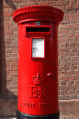 Famous classic red London and UK post office on the street, GB — Stock Photo