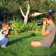 Royalty-Free Stock Photo: Two boys with vintage photo camera