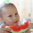 Cute baby eating watermelon — Stock Photo