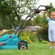 Little Boy Gardener mowing the lawn — Stock Photo #6740488