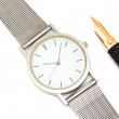 Watch and pen. — Stockfoto