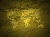 Buruşuk kağıt ve dünya haritası altın — Stok fotoğraf