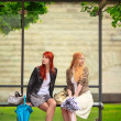 Two Girls at Bus Stop — Stock Photo