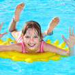 Stock Photo: Child on inflatable ring .
