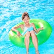 Child sitting on inflatable ring . — Stock Photo