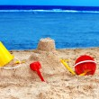 Kids toys on sand beach. — Stock Photo #5736117