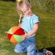 Child play with ball in park — Stock Photo
