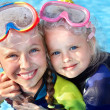 Children in swimming pool learning snorkeling. — Stock Photo #5736181