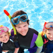 Children with mother  in swimming pool. — Stock Photo