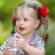 Child drinking glass of water. — Стоковое фото