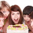 Group of happy young eat cake. — Stock Photo